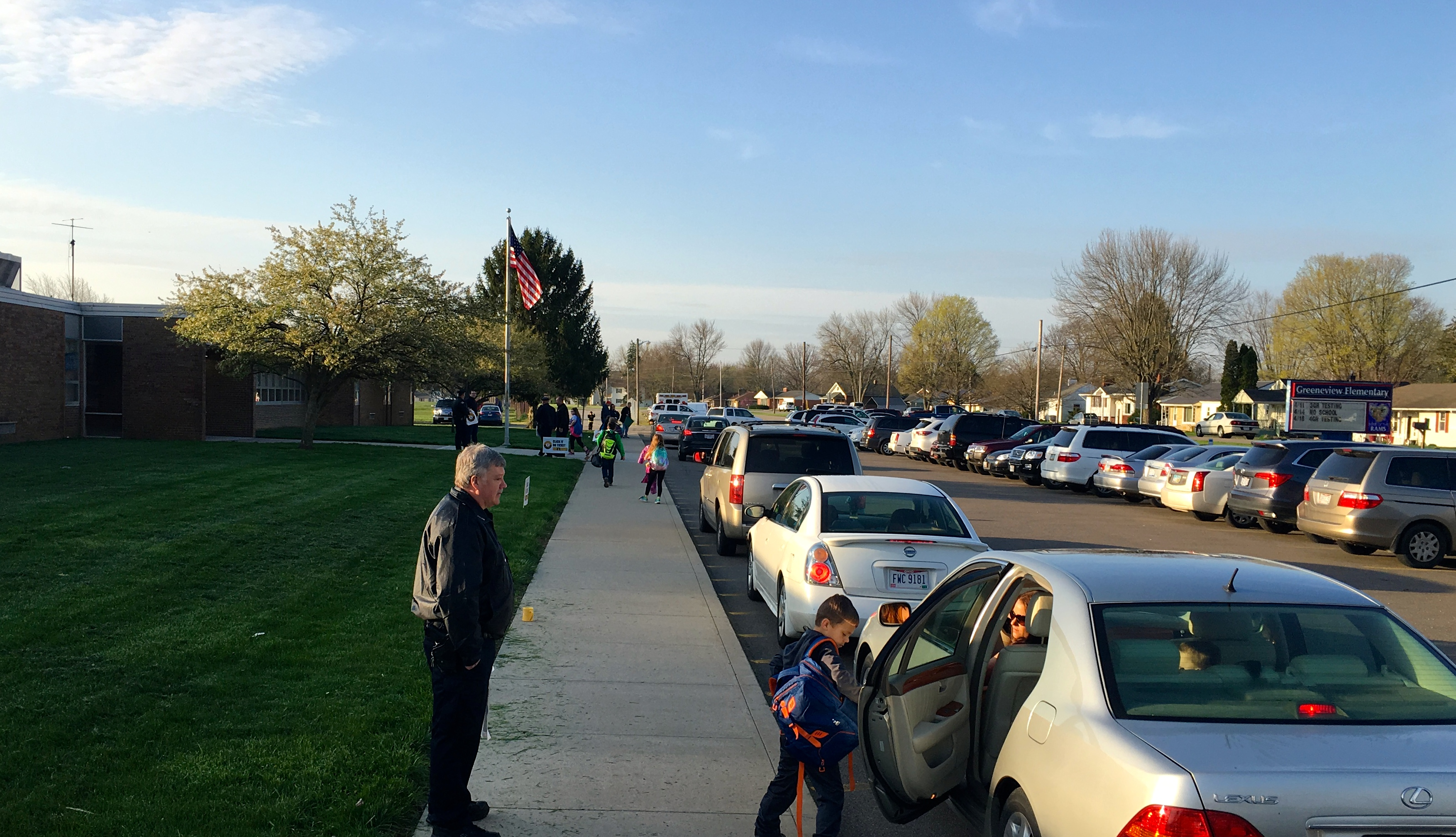 Jamestown PD Officer greets student during Student Drop Off
